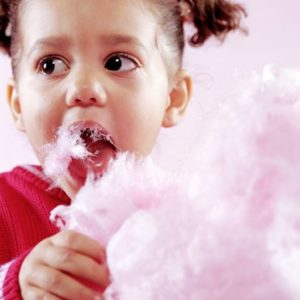 Girl (2-4) eating cotton candy